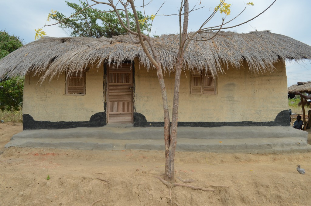 Malawi home built with rammed earth and thatch roof in Chizogwe village